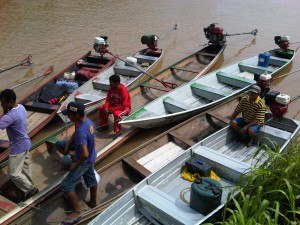 Motorized canoes used to transport us on the river