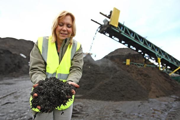 Susan Thoman, director of business development at Cedar Grove Composting, shows off the company's finished product. Photo by JOHN LOK / THE SEATTLE TIMES